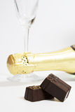 Wineglass, champagne, chocolate Royalty Free Stock Photo