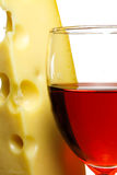 Wineglass and cheese. Wineglass with red wine and cheese close up.white background Stock Photo