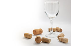 Wineglass with corks Stock Image