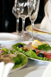 Wineglass and dishes. In restaurant Stock Images
