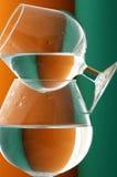 Wineglass em verde e na laranja Imagens de Stock