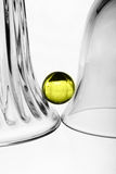 A wineglass, a glass vase and a ball Stock Photo