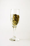 Wineglass with gold Stock Photos