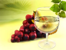 Wineglass and grapes Stock Photography