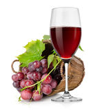 Wineglass and  grapes in a basket Stock Photography