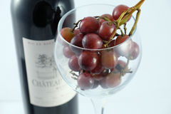 Wineglass, grapes and bottle Royalty Free Stock Images