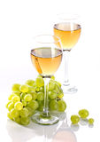Wineglass with grapevine and bunch grape Royalty Free Stock Photography