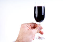 Wineglass in hand Royalty Free Stock Photos