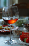 Wineglass with highlighted rose wine Royalty Free Stock Photography
