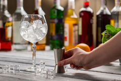 Wineglass with ice and jigger. Stock Photo