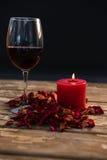 Wineglass by illuminated candle Stock Photography