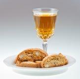 Wineglass italian cantuccini on saucer Stock Photography