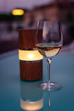 Wineglass and lamp at sunset Royalty Free Stock Image