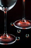 Wineglass legs. The close-up of wineglass basis and glass balls on a black surface Royalty Free Stock Images