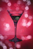 Wineglass with martini and olives Stock Photography