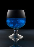 Wineglass with mysterious blue wine Stock Photos