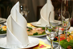 Wineglass and napkin. Table with wineglass and napkin in restaurant royalty free stock photography