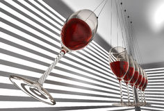 Wineglass newton cradle Royalty Free Stock Image