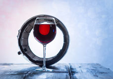 Wineglass and a old barrel Stock Photos
