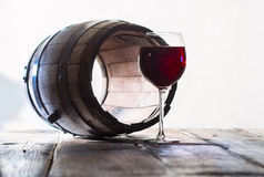 Wineglass and a old barrel Stock Images
