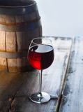 Wineglass and a old barrel Royalty Free Stock Photography