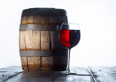 Wineglass and a old barrel Royalty Free Stock Image