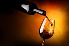 Wineglass on orange background Stock Images