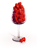 Wineglass overfilled with red hearts Royalty Free Stock Photo