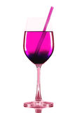 Wineglass with pink cocktail and straw Stock Images
