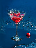 The wineglass with raspberries Stock Photo