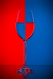 Wineglass on red and blue Royalty Free Stock Photos