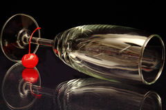 Wineglass with red cherry. On black background Royalty Free Stock Image