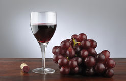 Wineglass and red grapes Royalty Free Stock Photography