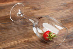 Wineglass with red ripe strawberry inside Royalty Free Stock Image