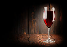 Wineglass of red win. E on a wooden background stock image