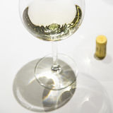 Wineglass served on a white table Royalty Free Stock Photos