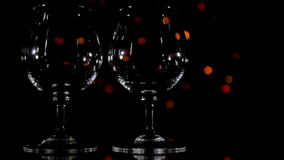 Wineglass and slow light background stock video footage