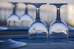 Wineglass on the table. Blue wineglass on the table royalty free stock image
