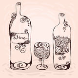 The wineglass and two bottles of wine Stock Photos