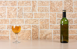 Wineglass on wall Stock Photos