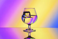 Wineglass with water and ice Royalty Free Stock Photos