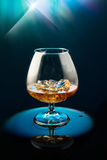 Wineglass with the whiskey and ice Royalty Free Stock Image