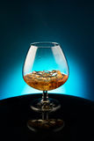 Wineglass with the whiskey and ice Stock Photography