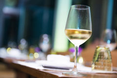 Wineglass with white wine in restaurant Royalty Free Stock Photo