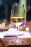Wineglass with white wine in restaurant Stock Photography