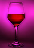 Wineglass wiht wine. In pink light Stock Photos