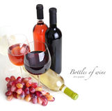 Wineglass, wine bottles and grapes Royalty Free Stock Photo