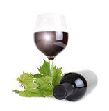 Wineglass, wine and grapes leaf Stock Images