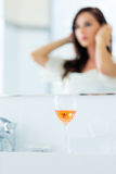 Wineglass and young woman. Photo of the beautiful wineglass on the young woman background Stock Photography