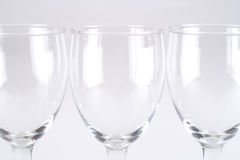Wineglasses. Three wineglasses in a row isolated on grey background Stock Photos